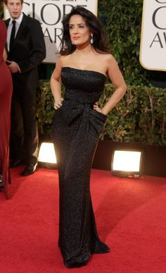 Gorgeous Red Carpet Look from the Golden Globes: Salma Hayek.  Keeping the neckline simple to make a statement with the earrings.