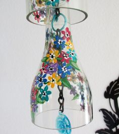 Clear wine bottle Wind Chime Flowers multi by LindasYardArtMaterials: Enamel paints, chain, Wine Bottles