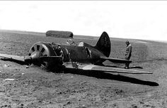 "Soviet fighter I-16, is stranded on a landing, ""the belly"". Picture taken by German soldiers, one of them near the plane"
