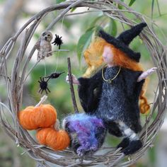 LOVE this Halloween Needle Felted Waldorf wreath by Daria Lvovsky via Etsy.