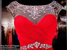 This cute red chiffon short homecoming dress has a high illusion sweetheart neckline completely covered with Crystals overflowing into the keyhole back. Gorgeous in red and it's at Rsvp Prom and Pageant, Atlanta, Georgia!