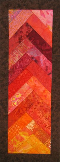 This striking decorative table runner is made in the colors of a sunset with special insulated batting to protect your table from heat and cold. It