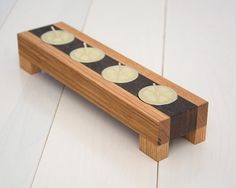 """This candle holder is made from reclaimed wood.  ◊ Oak wood ◊ Roasted maple wood ◊ Reclaimed wood ◊ Finished with natural linseed oil ◊ Tea lights no included  Each candle holder will vary in grain, tone and texture. The wood characteristics will vary with each piece.  MEASUREMENTS: 9 13/16"""" (24.9 cm) long 2 7/16"""" (6.2 cm) wide 1 11/16"""" (4.3 cm) tall  ------------♥------------ ♡ Thanks for visiting EcoKazen ♡ Return to our shop's home page: ecokazen.etsy.com"""