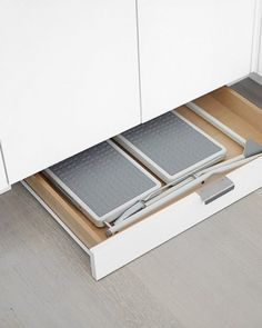 Under cabinet storage for a folding Step Ladder and all sorts of thin things.