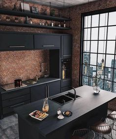 gorgeous black kitchen with exposed brick and crittal windows. Click to read about my house renovation plans and how the new floorplans look like!