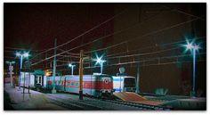 Maqueta H0-H0m. Nocturno. Imágenes de la estación de noche con diverso material.