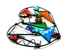 Funky stained glass heart suncatcher by DesignsStainedGlass