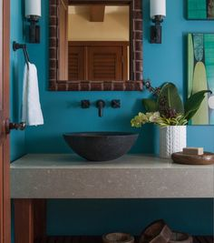 Bathroom: awesome stone bowl sink and turquoise accent wall