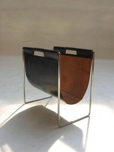 Gonna chase this bad boy down: Leather and chrome magazine holder on eBay