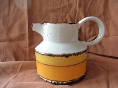 Midwinter Sun Cream Pitcher Made in England Stoneware by GrandmothersTable on Etsy Green Shelves, Brown Trim, Etsy Shipping, Stoneware, England, Sun, Dishes, Cream, How To Make