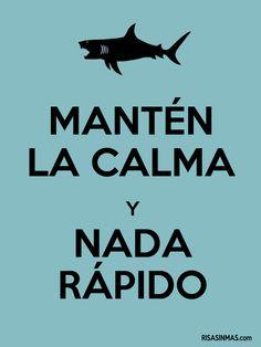 Translates to, Keep Calm and Swim Fast. Hahahahaha
