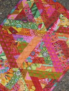 Kaffe Fassett Triangular Log Cabins, a Collision of Color | table mats at Badlands Quilts