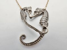 funny....fab.com has this listed for ON SALE @ $176.00.....the designers website sells it for $104.00.  want.  Seahorse Heart Pendant