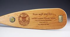 We're proud to brag about the fact that we regularly make canoe paddles for the Pentagon. This paddle was particularly memorable, because we inlayed a dog tag and a coin into the blade.