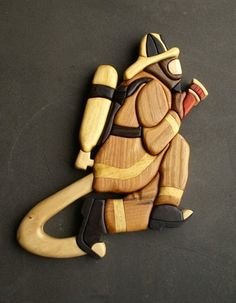 Since my Wife is a professional Firefighter I just had to do this one :) Thinking about adding more to it on the right side. Firefighter Intarsia Wood used : obeche, ebon. Woodworking Jobs, Intarsia Woodworking, Woodworking Patterns, Intarsia Wood Patterns, Dremel Wood Carving, Scroll Saw Patterns, Wood Toys, Wood Wall Art, Decoration
