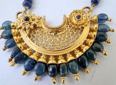 Vintage antique 22 K solid gold blue sapphire by TRIBALEXPORT, $4999.00