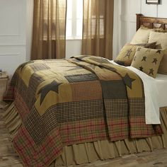 Primitive Quilt Set Luxury King Stratton Patchwork Star with Shams Skirt Pillow -- The Stratton Quilt displays a large primitive star in a country-inspired plaid set on a khaki ground, featuring a muted color palette of mustard, brown, green and red-orange.  Great for decorating a primitive style bedroom!  #primitivebedroom #patchworkquilts #quilts