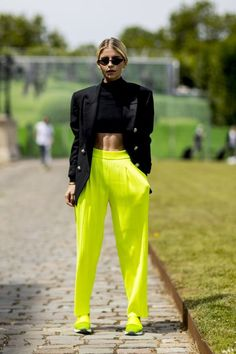 'Street Style: Proof the best dressed at Men's Fashion Week Spring 2019 were the women.' - The Fashion Spot Women dressed in neon trousers, paired with a smart black blazer, combining the futuristic trend with military style. Mens Fashion Week, Black Women Fashion, Look Fashion, Urban Fashion, Autumn Fashion, Classy Fashion, Petite Fashion, 70s Fashion, Cheap Fashion