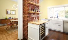 We exposed the brick work of the chimney to provide a back drop for the home bar.
