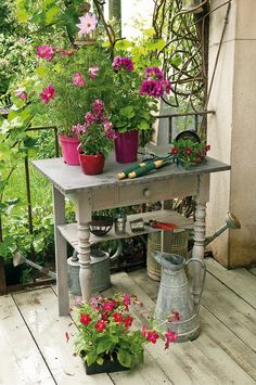 A rustic, painted table is repurposed as a lovely garden bench.