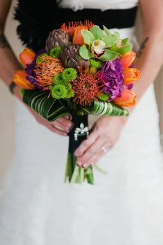 purple, orange and green succulent bouquet