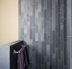 Idea: a floor-to-ceiling strip of these slate tiles as an accent in a white-tiled bathroom.