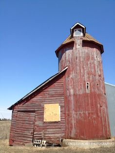 Faded red barn against a bright blue sky!