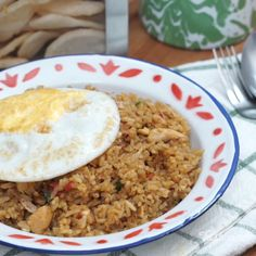 Delicious fried rice served with fried egg on top.