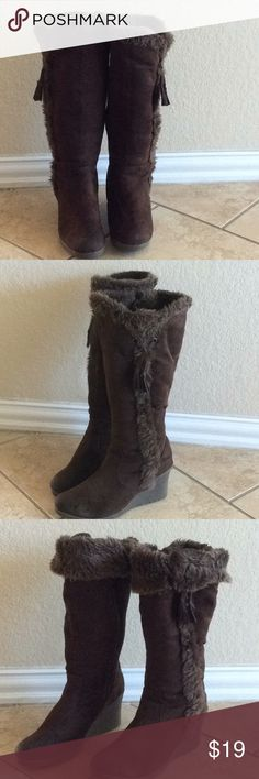 Fur warm boots These perfectly furry boots are stylish and warm. Color brown size 7 in great preowned condition. Warm, cozy and soft. Shoes Heeled Boots