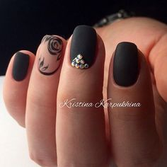 Another black themed rose nail art design. This gorgeous nail art design is simply elegant with the combination of matte black colors and a silhouette design of a rose.