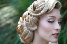 Glamorous, soft, and lovely 40s romance hair style.
