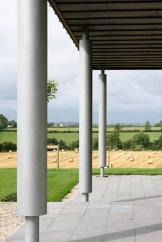 Underside of standing seam zinc canopy supported by powder coated columns with views towards the countryside. Passive House Design, Irish Landscape, Architectural Services, Irish Traditions, Columns, Canopy, Countryside, Pergola, Powder