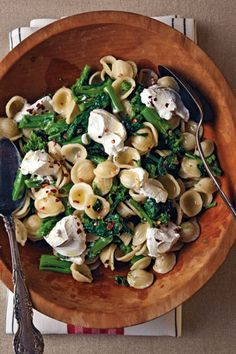 Slightly bitter rapini (also known as broccoli rabe) marries well with tangy goat cheese in a pasta recipe that's ideal for summer picnics and potlucks. Summer Pasta Dishes, Pasta Recipes, Cooking Recipes, Salad Recipes, Vegetarian Main Course, Vegetarian Recipes, Healthy Recipes, Healthy Foods, Good Food