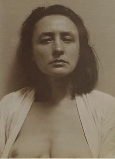Georgia O'Keeffe by Alfred Stieglitz.  Circa 1918, so this is the artist as a young woman.  Stieglitz took many photos of her over the years.