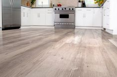 Gray Ash Click Together Vinyl Flooring   -Commercial grade durability with a 20mil wear layer -Rapid-locking system for DIY installation -50 Year Residential Warranty -100% waterproof and easy to clean