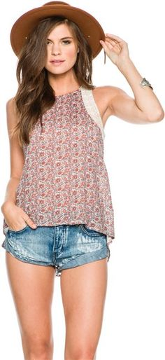 O'Neill Gypsy Soul tank.   Women's graphic tank top.   Soft screenprint at front.   Drop tail hem with side vents.   Strap width: 1.5 inches.   Shoulder to hem length: 27.8 inches.   509olyester, 38,otton, 12;ayon.   Machine wash cold, tumble dry low.   Imported.   Vendor style #: SP6423002.     Size & Fit Guide  Model is wearing size Small. Model's height: 5'9 Model's chest: 31 inches. Model's waist: 24 inches. Model's hips: 34 inches.