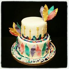 Bohemian themed birthday cake by Cakes-N-Sweets. Handmade feathers and gold arrows