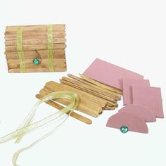 treasure chest made out of paddlepop sticks, foam, and ribbon. Great for party craft fun.