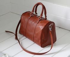 https://www.etsy.com/listing/168166922/brown-leather-duffle-bag-leather-carry?ref=shop_home_active_7