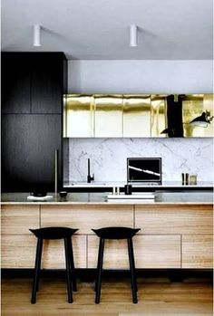 Black + marble + plywood kitchen