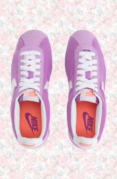 Kick back in classic '70s running style with these cute fuchsia Nikes.