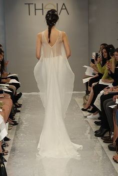 This delicate beaded crop (with train!) from Theia.   21 Completely Stunning Crop Top Wedding Gowns