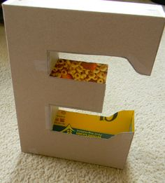 DIY Cardboard Letter with Découpage Tutorial – Attention To Balance Cardboard Letters, Cardboard Toys, Diy Letters, Cardboard Design, Giant Letters, Cardboard Storage, Cardboard Playhouse, Diy Cardboard Furniture, Cool Furniture