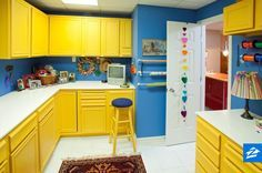 Fuel creativity in your craft room with bright cabinetry and wall colors!