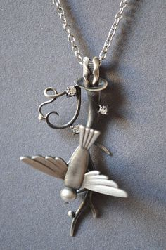 Falling Bird Necklace Made With Solid Cast by dolldisasterdesign,