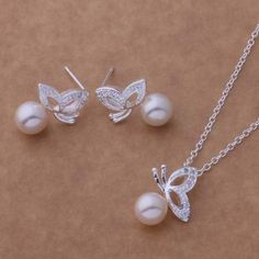 · Arrives in a Silver Bullion Gift Bag/Box. Butterfly Pearl Pendant Necklace and Earrings Set. · Sterling Silver Pendant Necklace and Stud Earrings Set. Pearl Pendant Necklace, Pearl Jewelry, Boho Jewelry, Bridal Jewelry, Jewelry Sets, Fashion Jewelry, Boho Fashion, Gold Jewellery, Jewelry Rings
