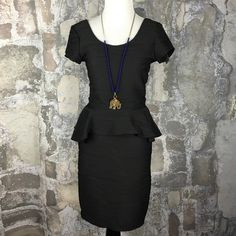 Little black peplum stretchy open back dress Brand new with tags. Size medium. 95% polyester, 5% spandex. The perfect 'little black dress'. Brat Star Dresses