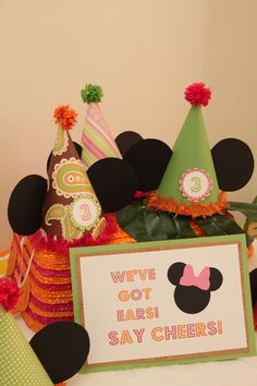 Gracie's Minnie Mouse Luau party hats - hat template found at http://jonesdesigncompany.com/tutorial/party-hat-tutorial/