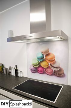 Rainbow Macaroons printed glass splashback. Shop from over 400 designs, or provide your own. All of our splashbacks are: Heat Resistant to 200 degrees, toughened safety glass, available in any size, and all come with a seven year warranty. Visit diysplashbacks.co.uk to discover more.