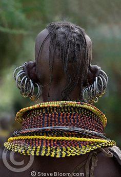 Africa | Turkana woman, with multiple earrings and elaborate bead collar, Lake Turkana, Northern Kenya | © Steve Bloom
